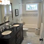 bathroom with black vanity