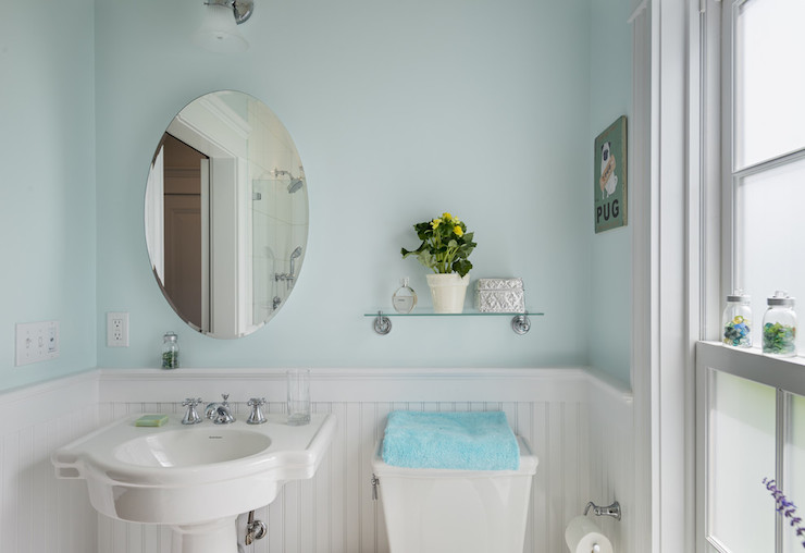 Shelves Over The Toilet As Additional Storage For Bathroom Supplies