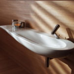 Long and Narrow Sink on Wood Paneled Wall